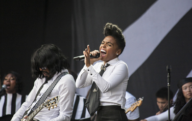 Janelle Monea live on stage with band